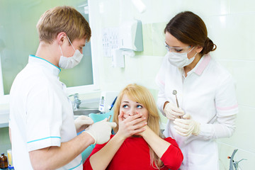 Scared patient in dentist office