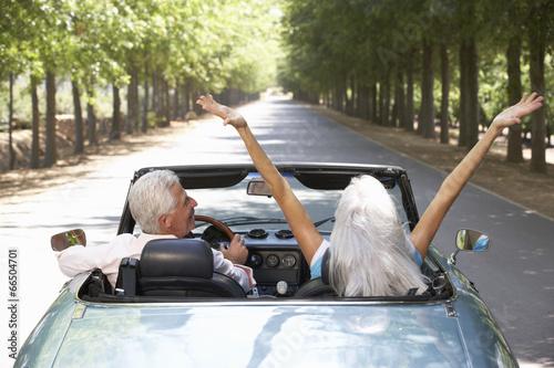 Senior couple in sports car - 66504701