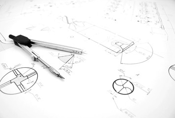 Compasses and drawing.