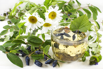 Summer tea with healing herbs and berries