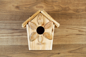 New Wooden Birdhouse on Rustic Wood Boards