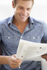 Man reading instruction book