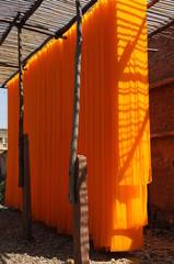 orange fabric, textile Industry , rural Rajasthan, India
