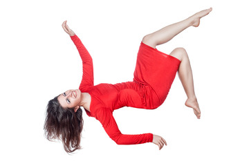 Woman in red dress laughs and falls.