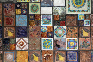 Italy, Cinque Terre, Riomaggiore. Decorative tiles on wall