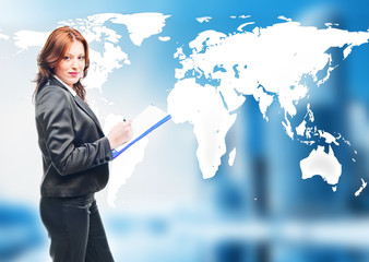 businesswoman   standing in front of an earth map