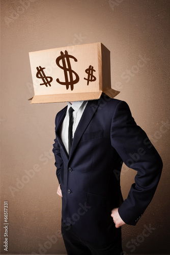 Businessman gesturing with a cardboard box on his head with doll