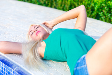 Pretty Blonde Woman relaxing outdoor