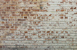 Fototapety Background of old vintage dirty brick wall with peeling plaster