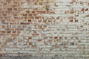 Background of old vintage dirty brick wall with peeling plaster