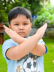cute boy show stop hand symbol.