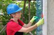 Wall insulation, female worker cut mesh on styrofoam insulation