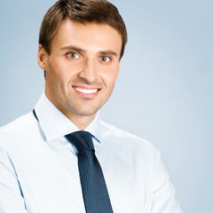 Portrait of business man, over blue background