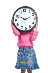 Asian little girl hold a clock close her face