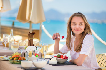 Beautiful young woman in a beach restaurant
