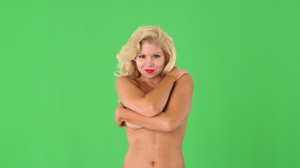 Sexy nude blond woman covering breasts