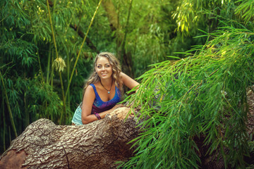 A beautiful girl in a bamboo grove