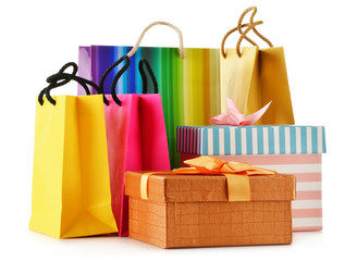 Gift boxes and colorful gift bags isolated on white