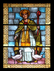 St Martin, stained glass in the church in Porto Azzurro, Italy