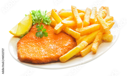 Fotobehang Restaurant Fried crumbed veal escalope with French fries