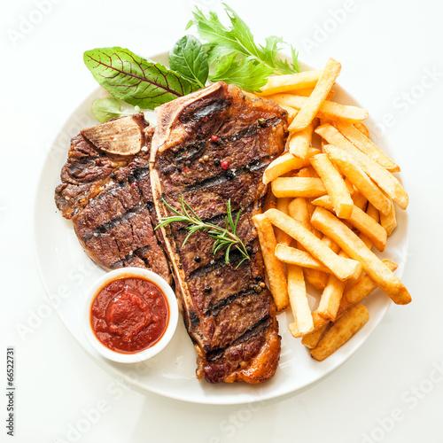 Fotobehang Restaurant Grilled t-bone steak seasoned with rosemary