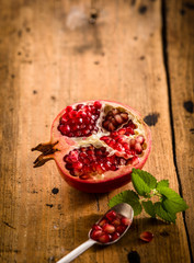 Halved fresh pomegranate with seeds