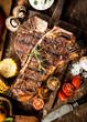 Grilled t-bone steak in a rustic kitchen - 66523131
