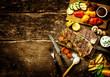 Preparing t-bone steak and roast vegetables