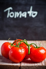 fresh tomatoes and blackboard