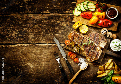 Preparing t-bone steak and roast vegetables - 66523132