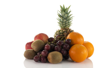 fruit as oranges pineapple grapes and kiwi