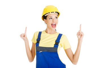 Woman construction worker pointing