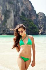 Beautiful young woman posing in the sea in bikini
