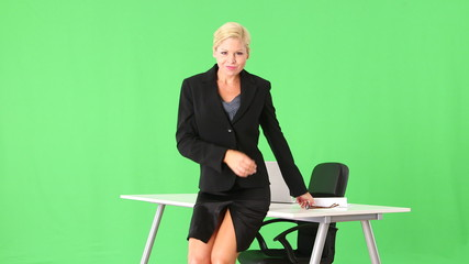 Alluring and provocative businesswoman being sexy by desk