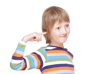 Boy in Colorful Shirt Pointing Finget to his Head