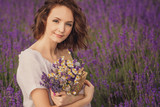 Fototapety Smiling beautiful brunette in the lavender field