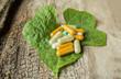 Herb capsule on leaf.