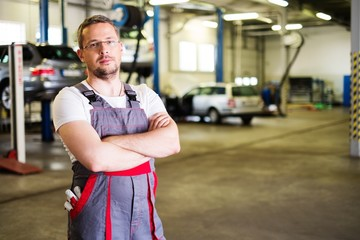 Serviceman in a car workshop