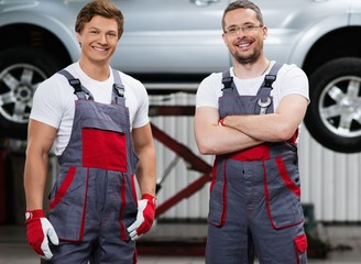 Two serviceman in a car workshop