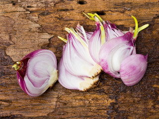 onion bulb and sliced onions on wooden