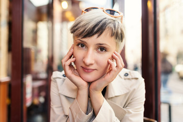 Beautiful young woman intimate portrait in a cafe in Paris, Fran