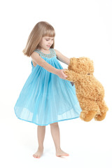 The girl whirls with teddybear