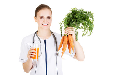 Doctor holding healthy carrots and juice.