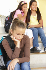 Unhappy Pre teen girl in school