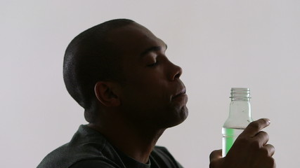 Young man drinking from a water bottle