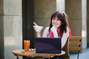 Student or freelance worker with laptop in a cafe