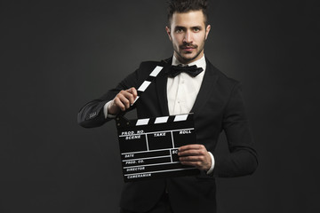 Man holding a clapboard