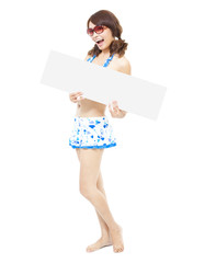 pretty sunshine girl standing and holding a board