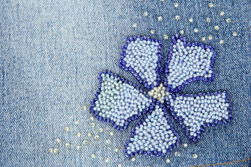 Blue jeans with flower closeup