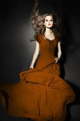 Fashion model in long dress